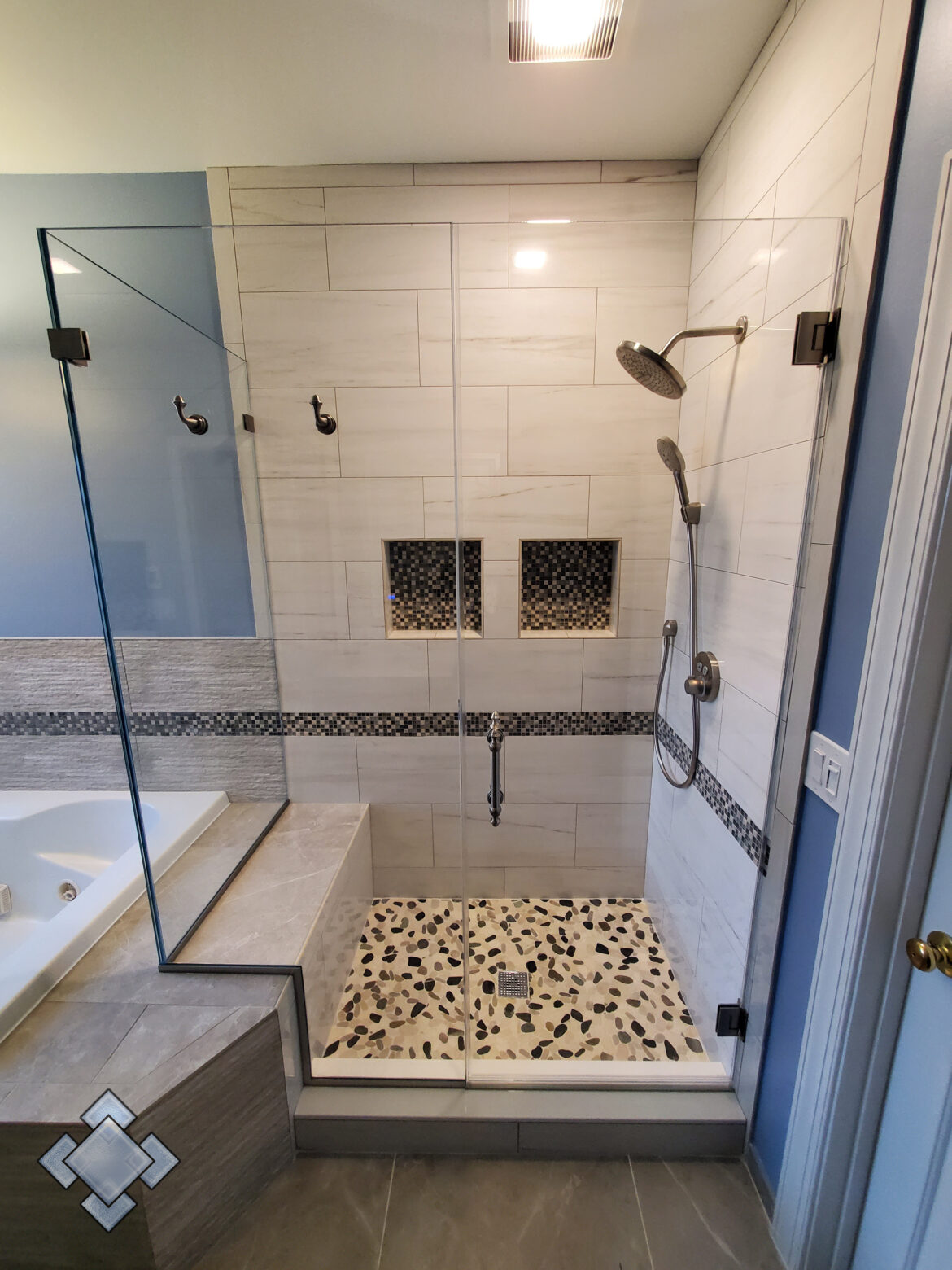 Corner shower unit in Alexandria Virginia with Symphony hardware