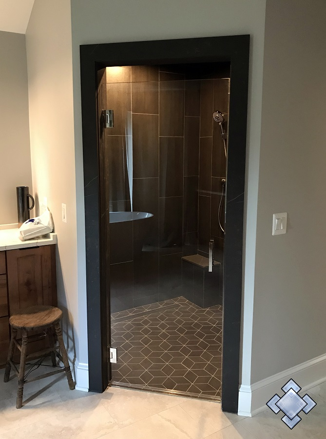 Swing glass door to wet room shower enclosure