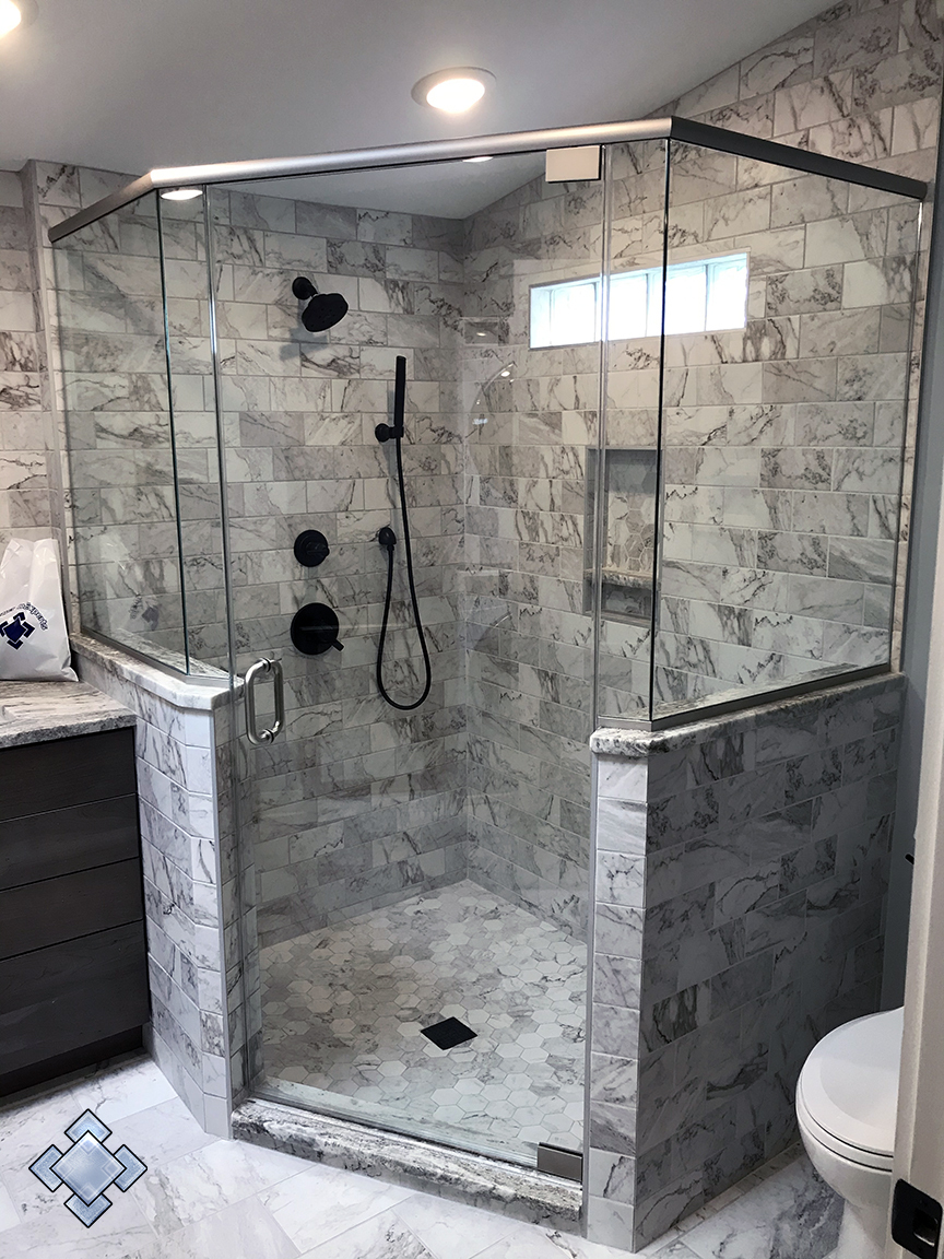 frameless swing shower enclosure with a metal header in Catonsville Maryland