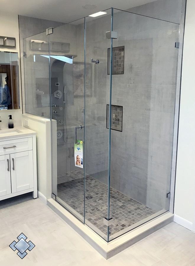 Custom renovation of a corner shower unit with glass door