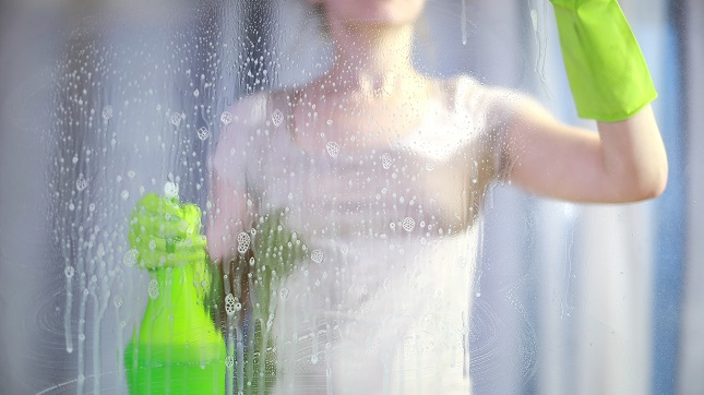 Person cleans glass shower door