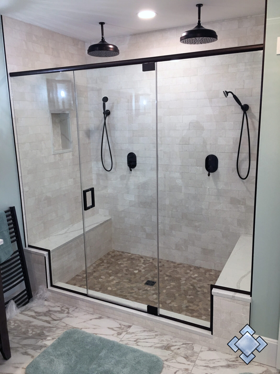 Shower door with oil rubbed bronze hardware and header