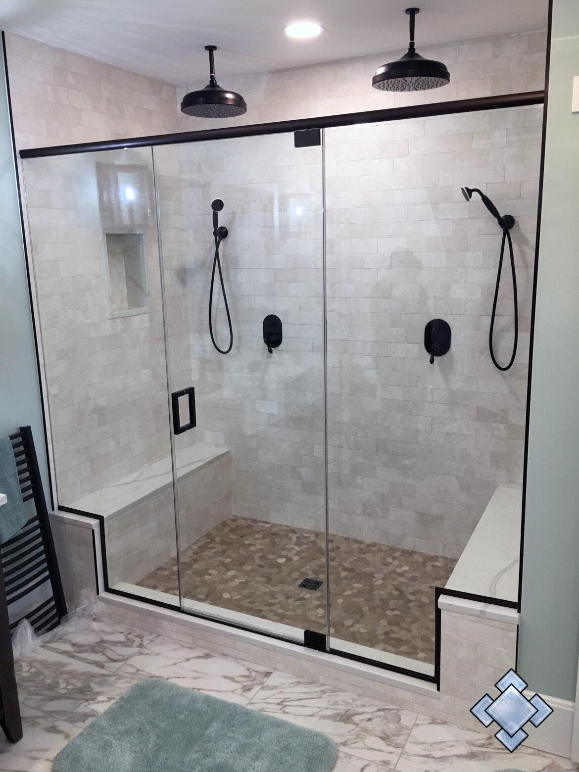 Shower door with oil rubbed bronze hardware and header