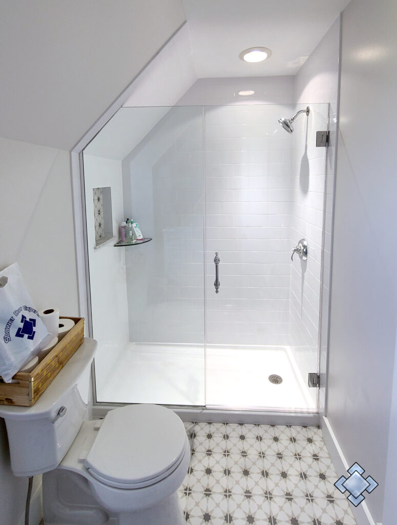 Angled Cape Cod shower door with white tile in custom shower enclosure